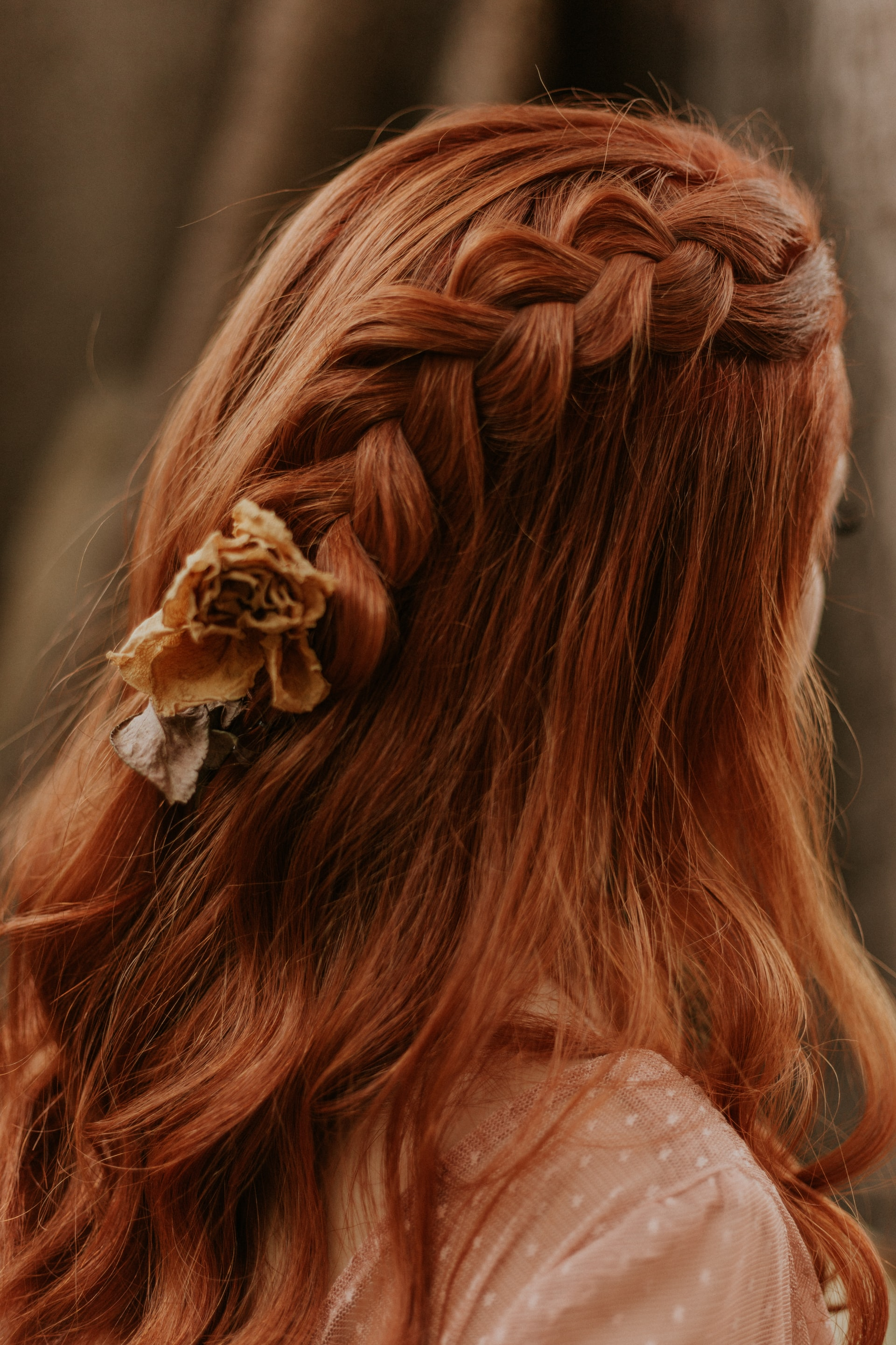 braid in long red hair
