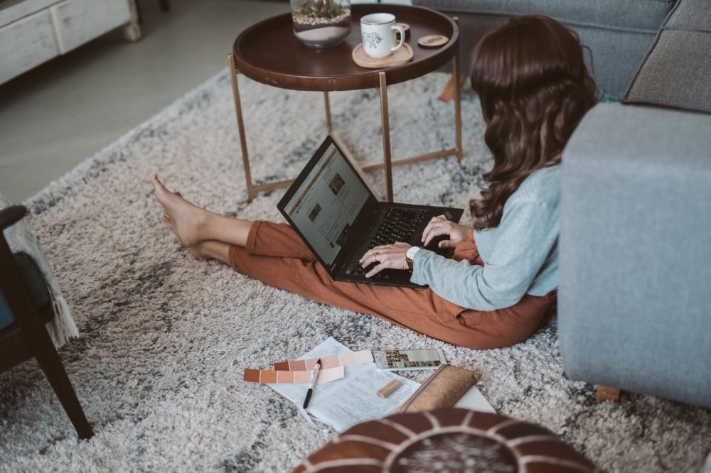 woman sitting on floor with computer