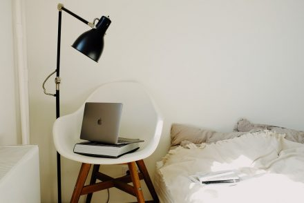 black lamp next to white chare