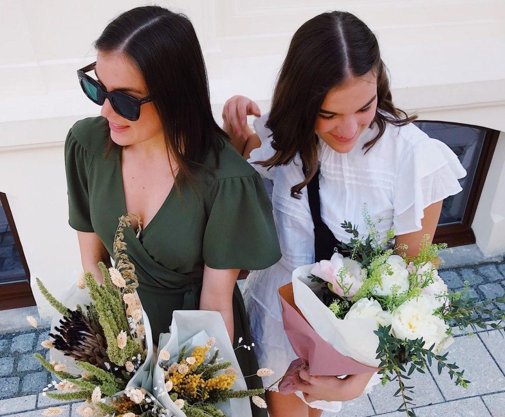 women holding flowers