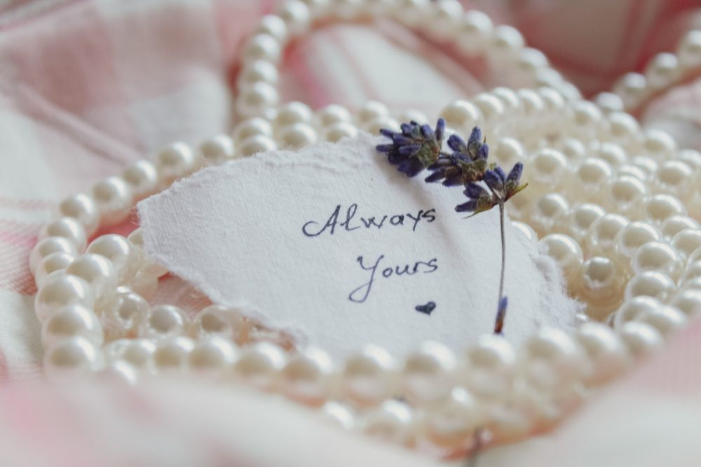 pearls next to a note