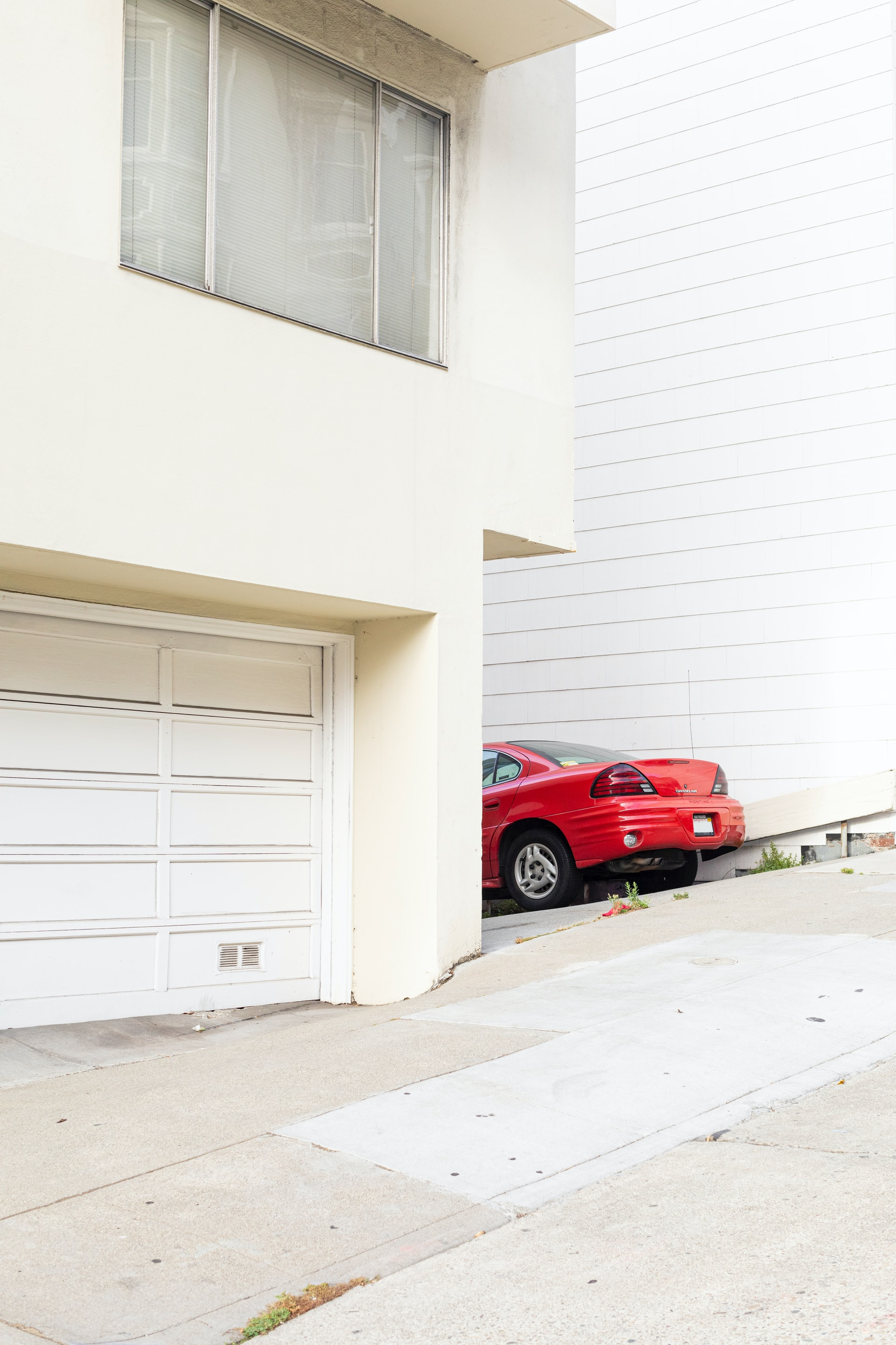 garage door with red car