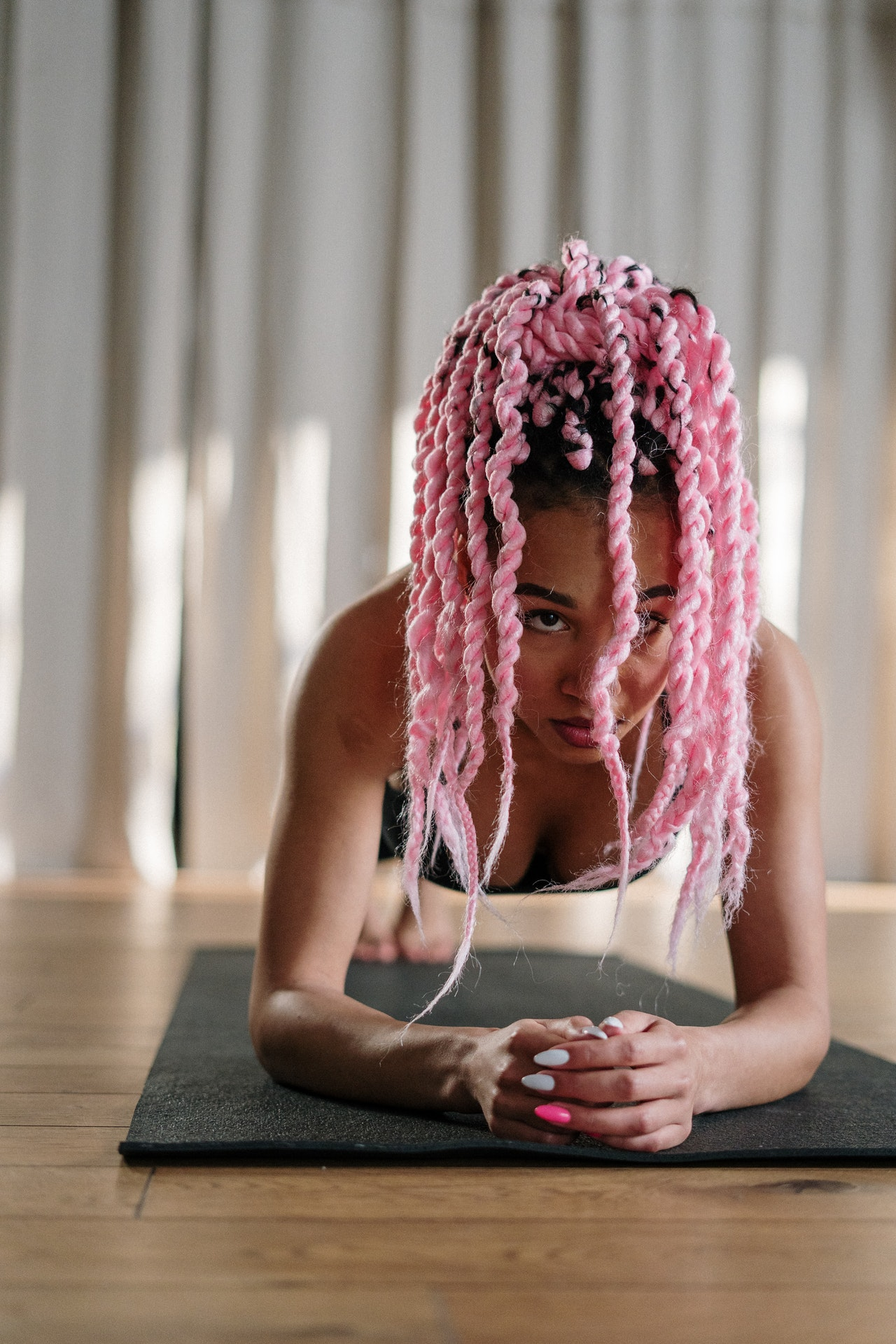Woman with pink braids