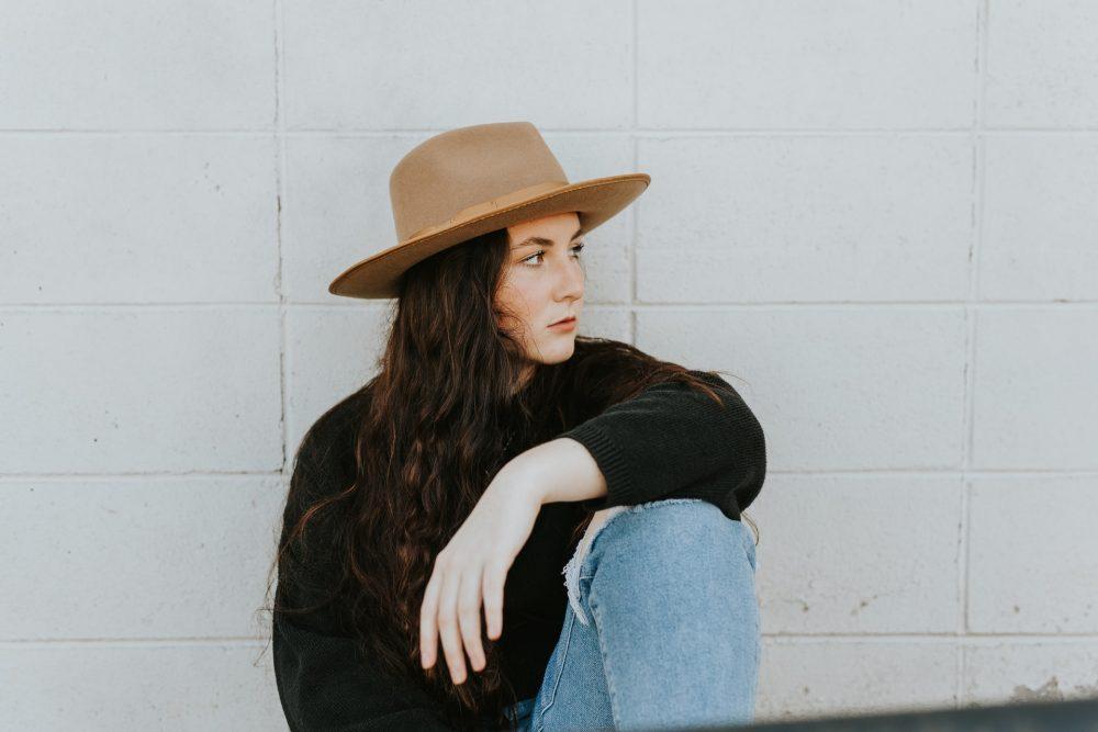 woman in wide rim hat