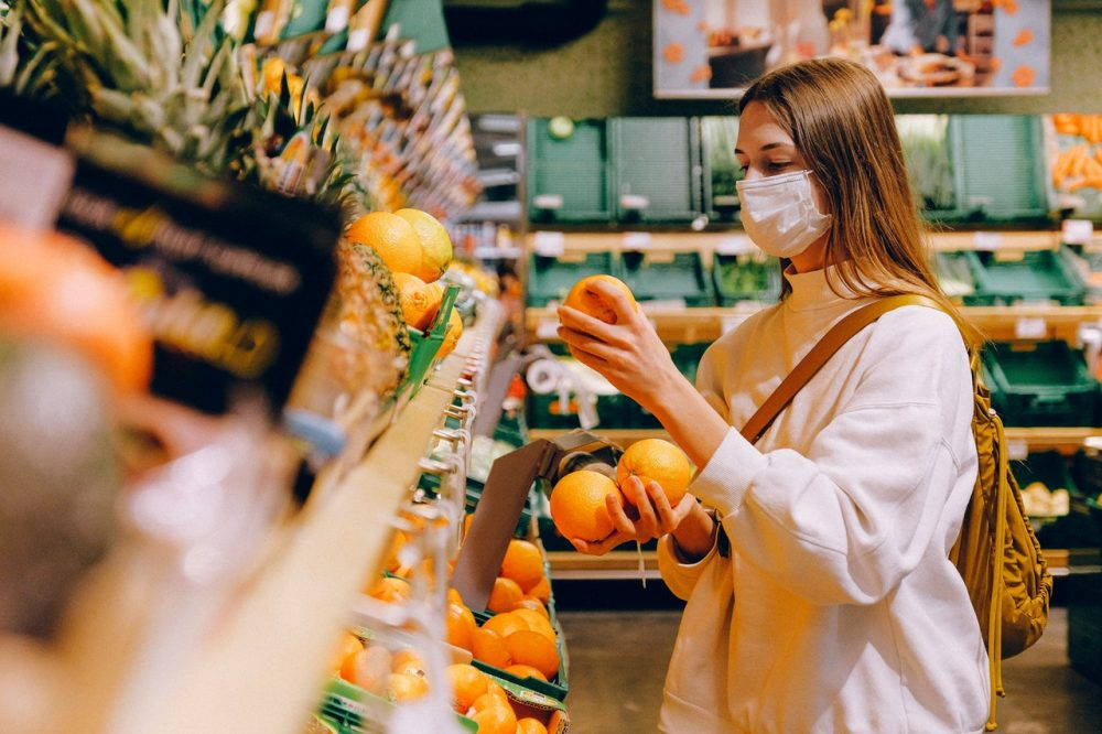 woman wearing face mask in supermarket