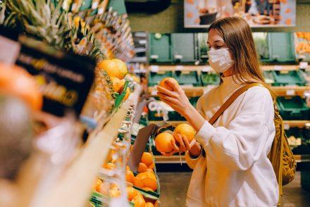 woman wearing face mask in supermarket