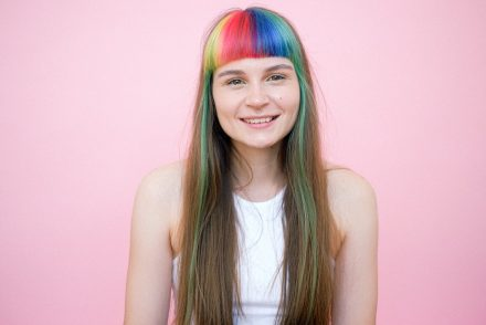 Woman with rainbow bangs