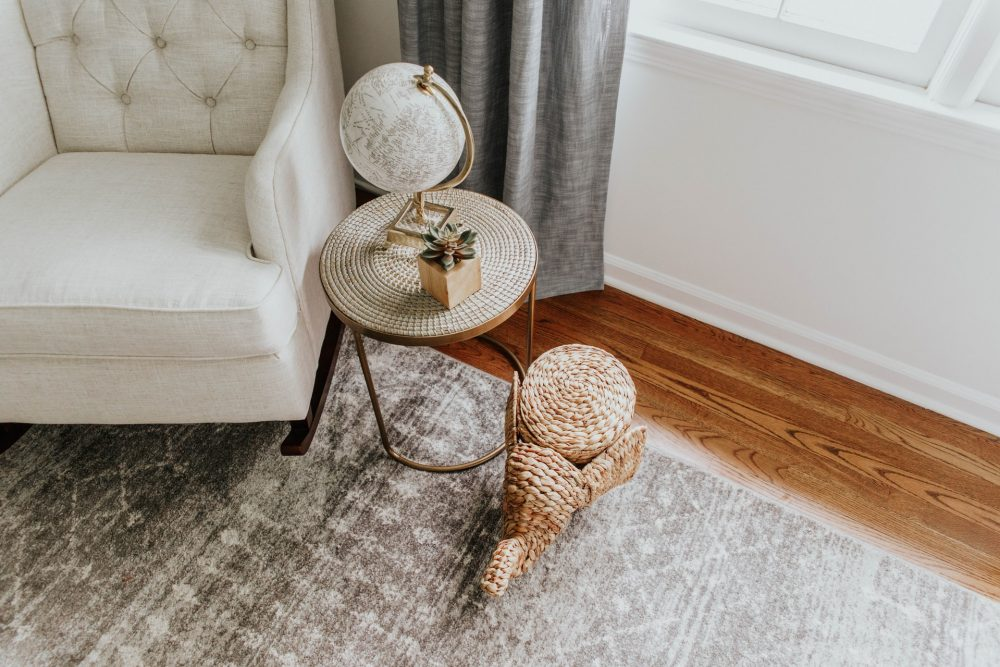 white living room chair in a corner