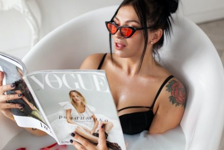 Woman reading vogue