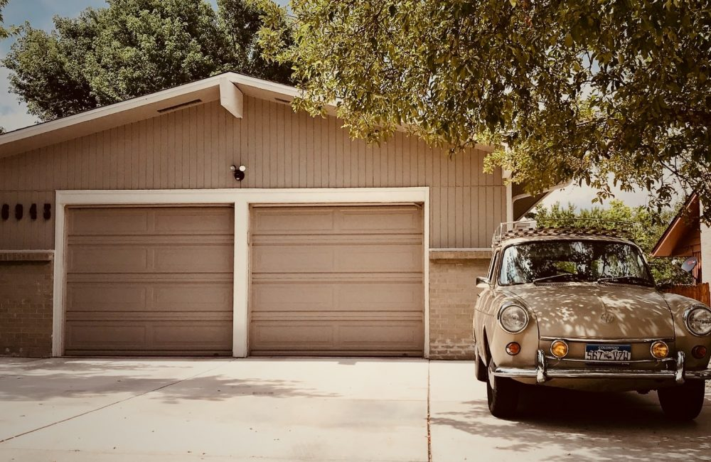 old car in front of garage