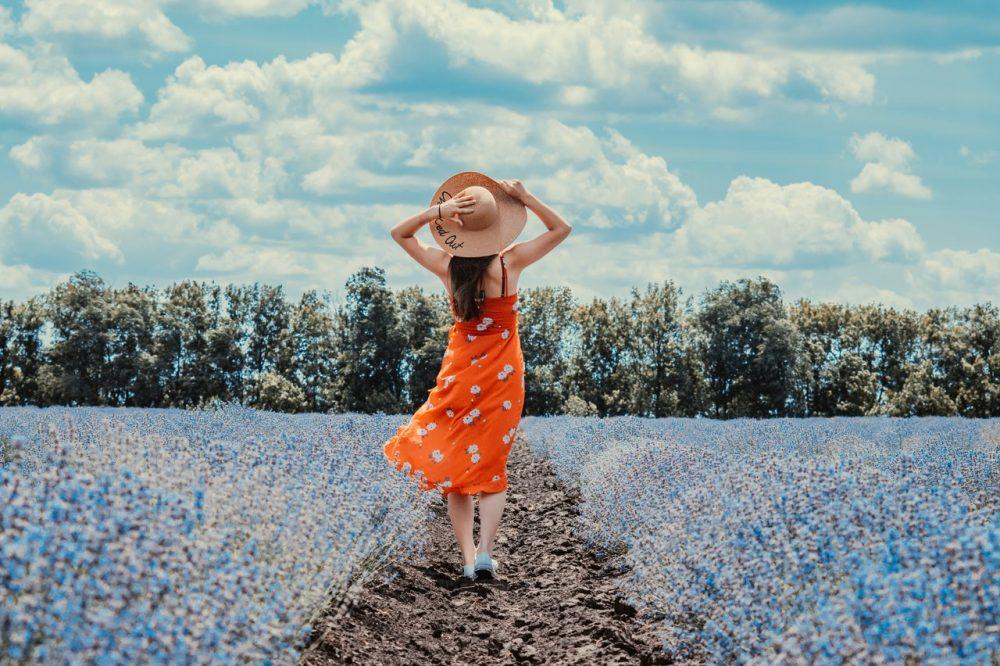 woman standing in flower field