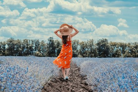 woman standing in flower field