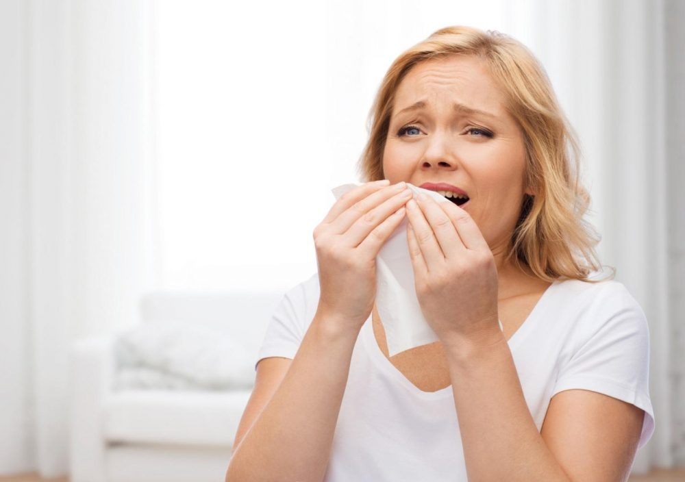 Woman about to sneeze