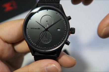 man holding watch