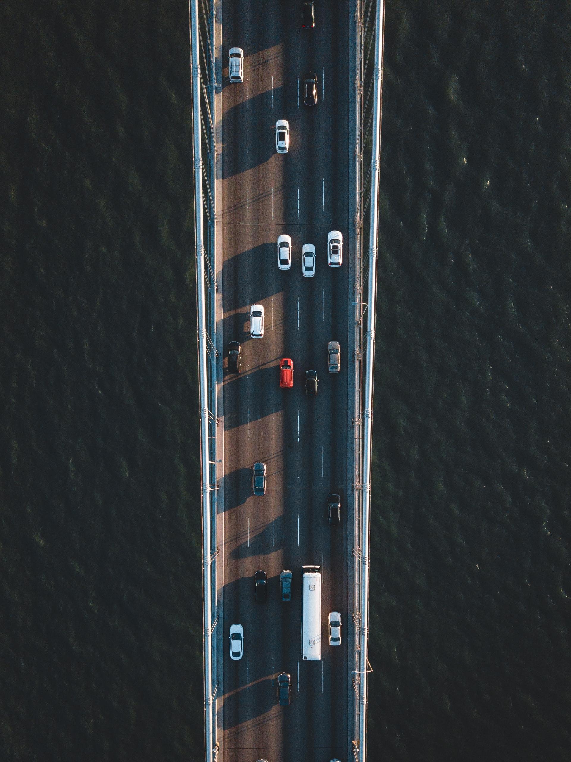 cars on a highway bridge