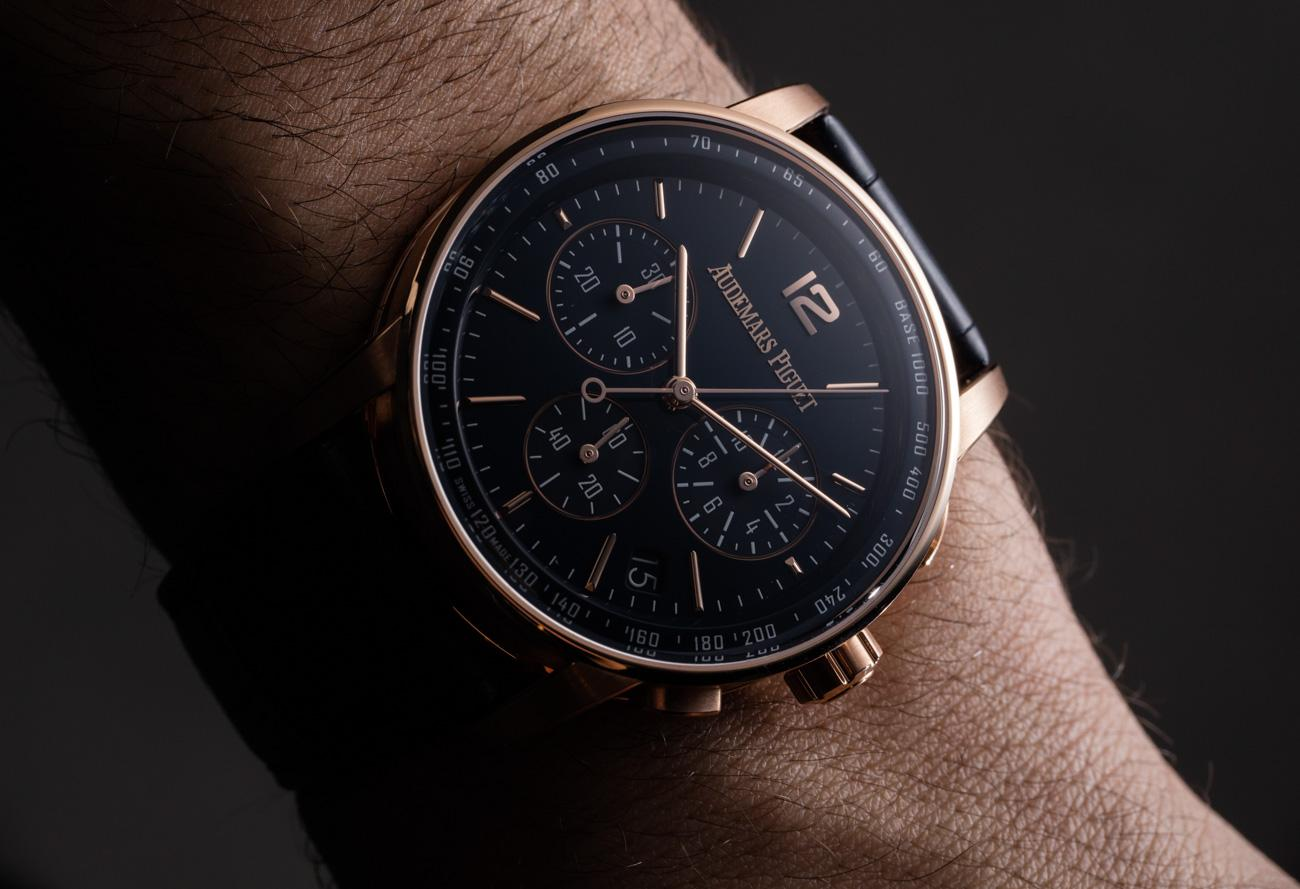 man wearing a gold and black watch.