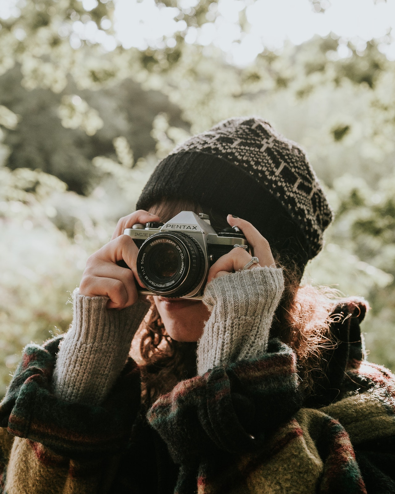 woman taking photo with a Pentax