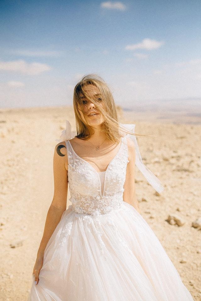 woman wearing sleeveless wedding dress in the desert.