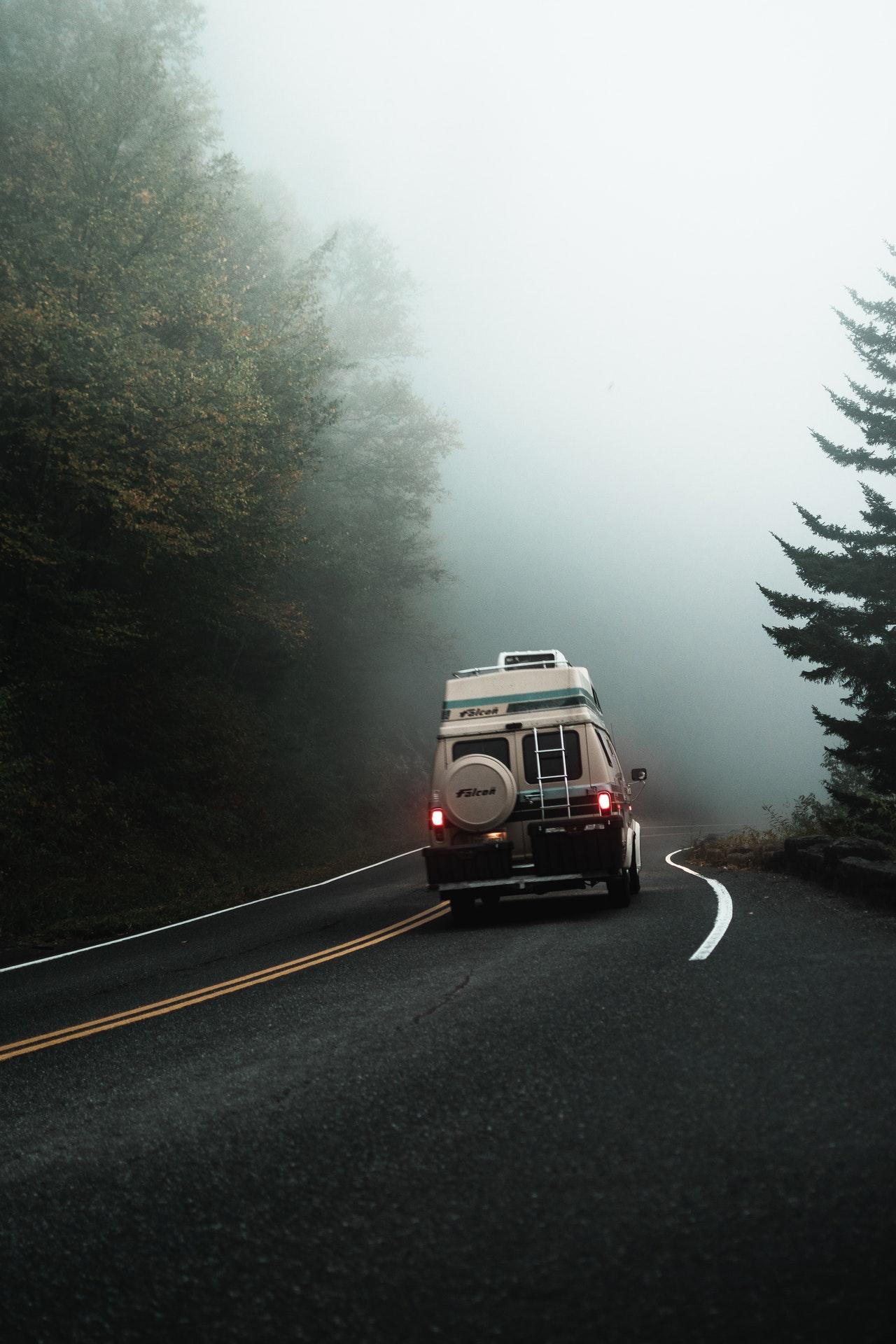 RV on foggy road