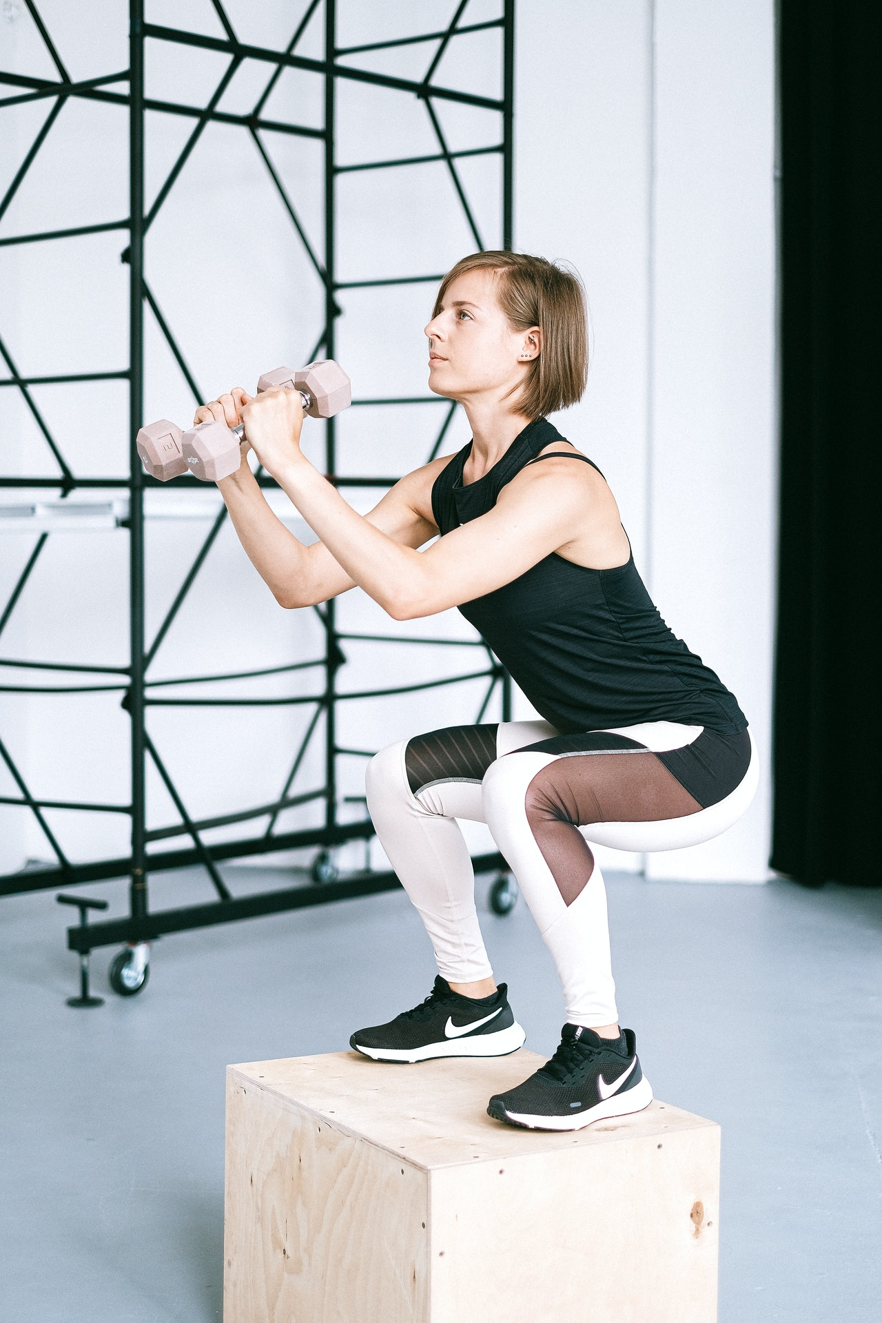 Woman doing squats on a box