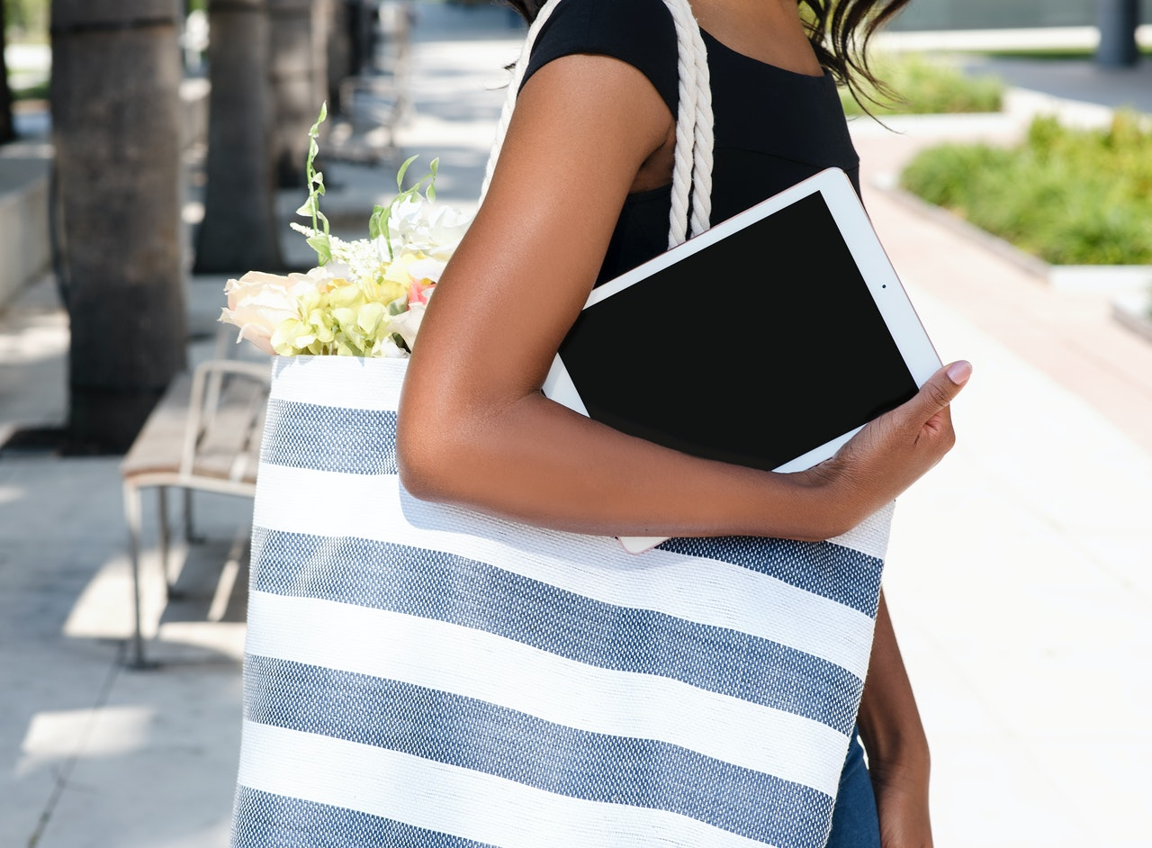 woman holding an iPad