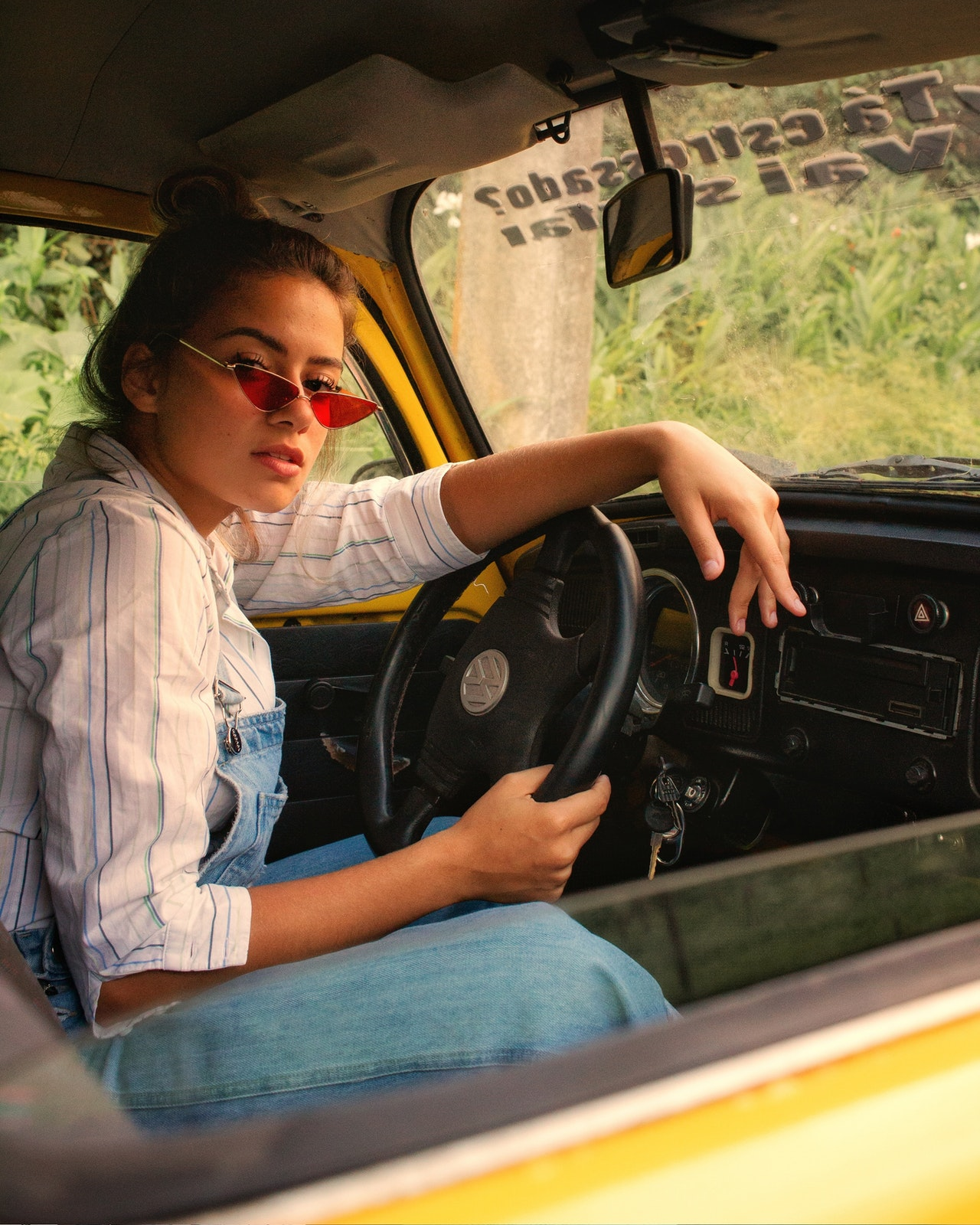 woman driving old VW