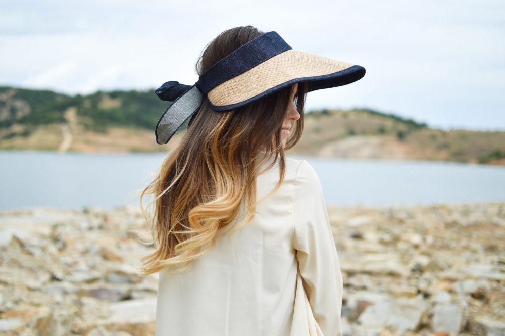 Woman in straw visor