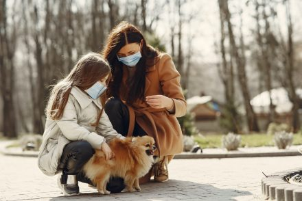 Woman and child in face masks