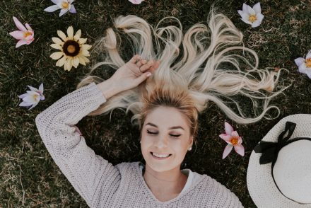 woman with hair laid out with flowers