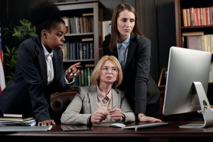 lawyers looking at computer
