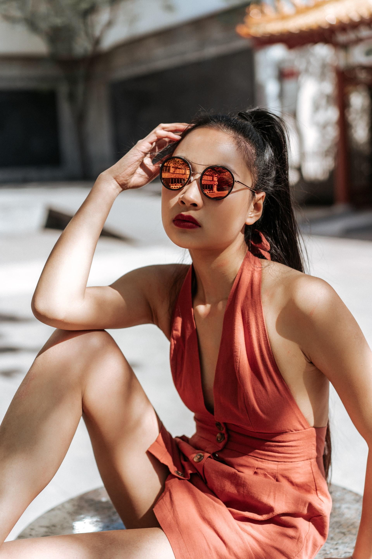 mirror sunglasses and orange dress