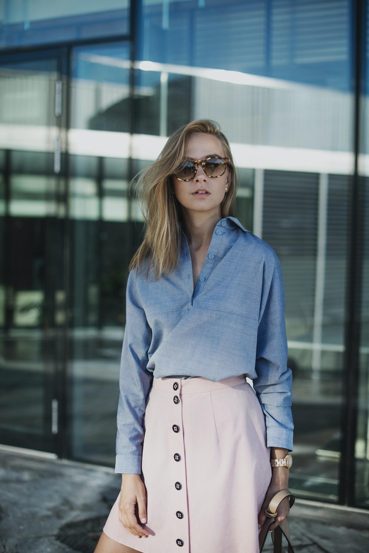 woman in sunglasses in business casual attire.