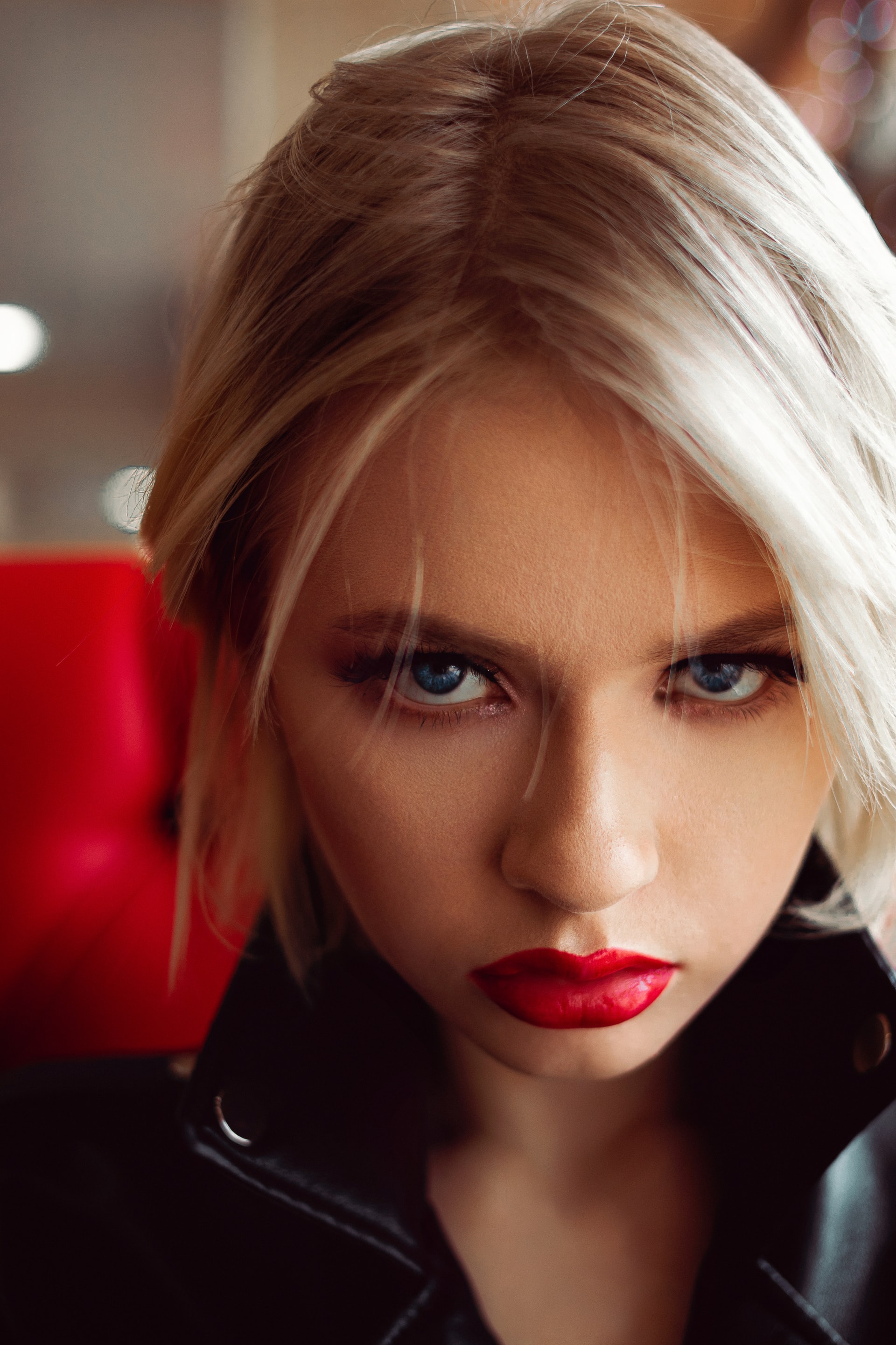 bright red lipstick and blonde hair
