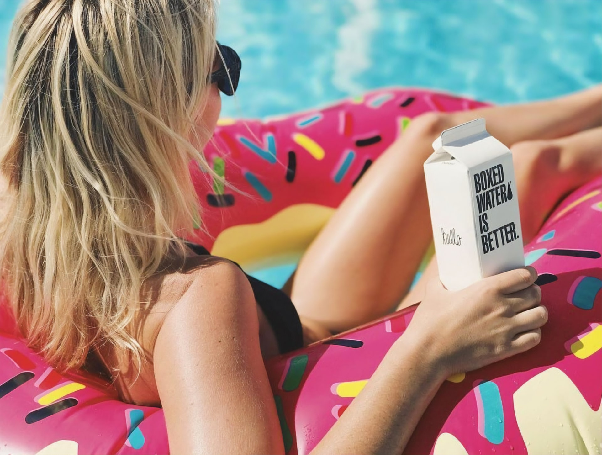 relaxing on a pool float boxed water is better