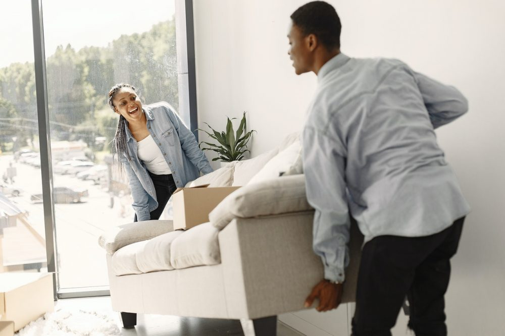 couple moving couch together