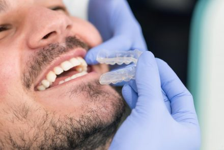 man getting Invisalign