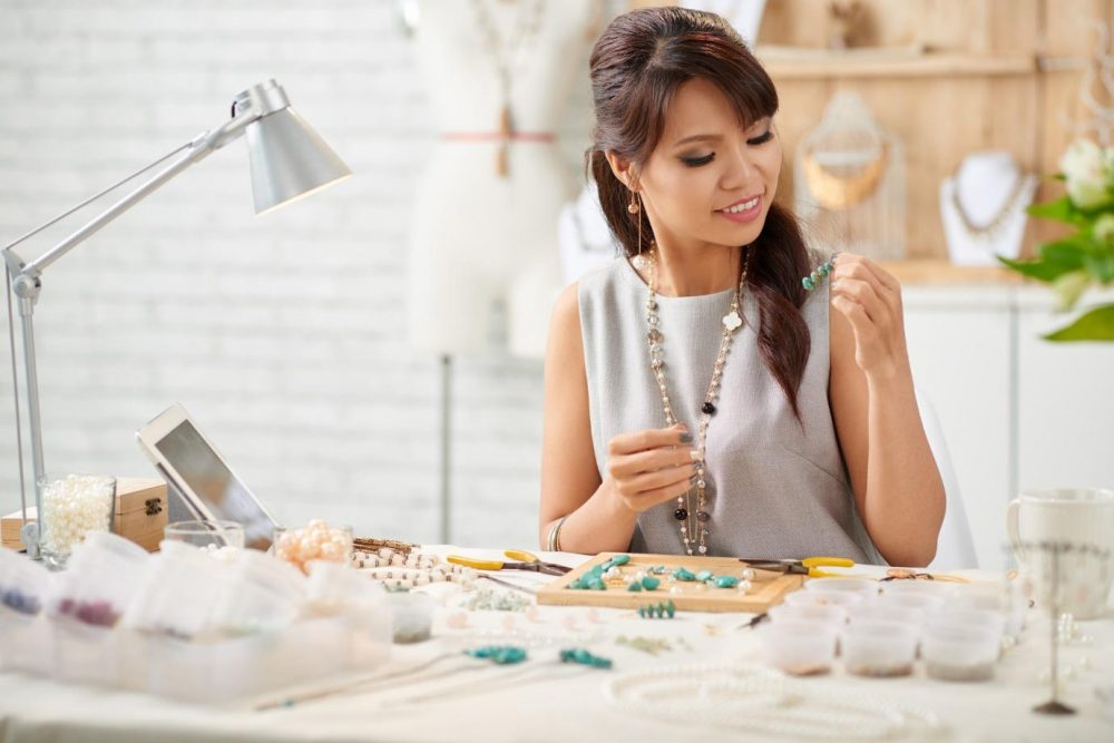 woman making jewelry