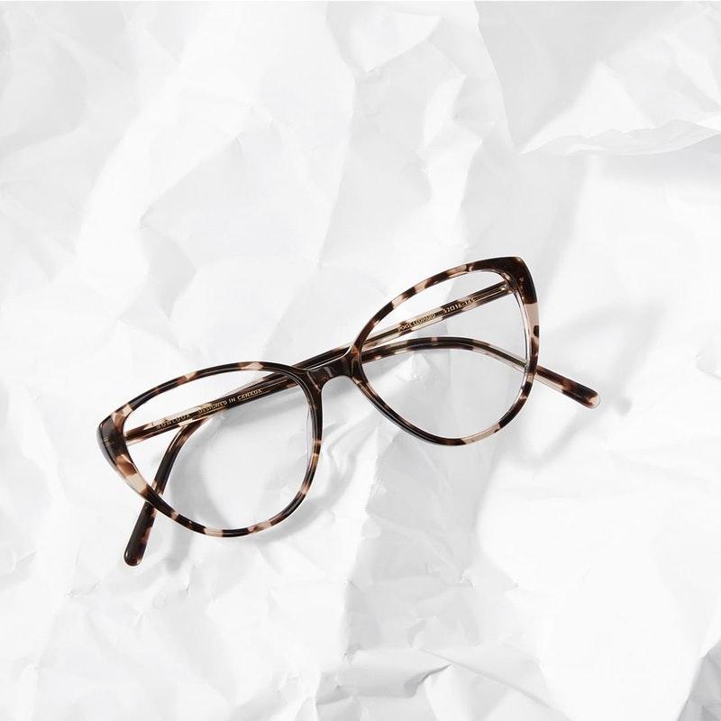 cat eye glasses on white background
