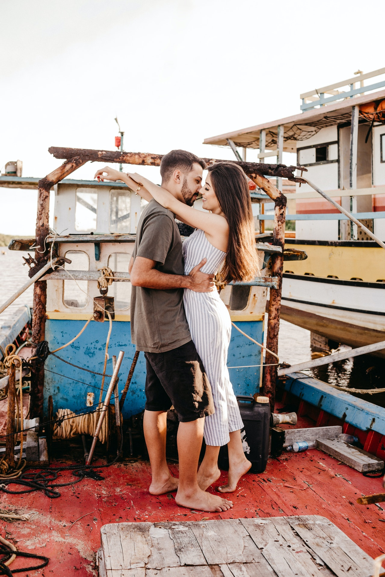 couple kissing on a small boat