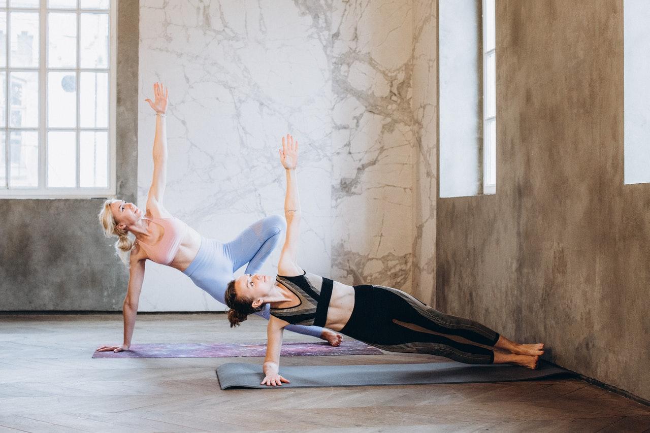 women doing side planks
