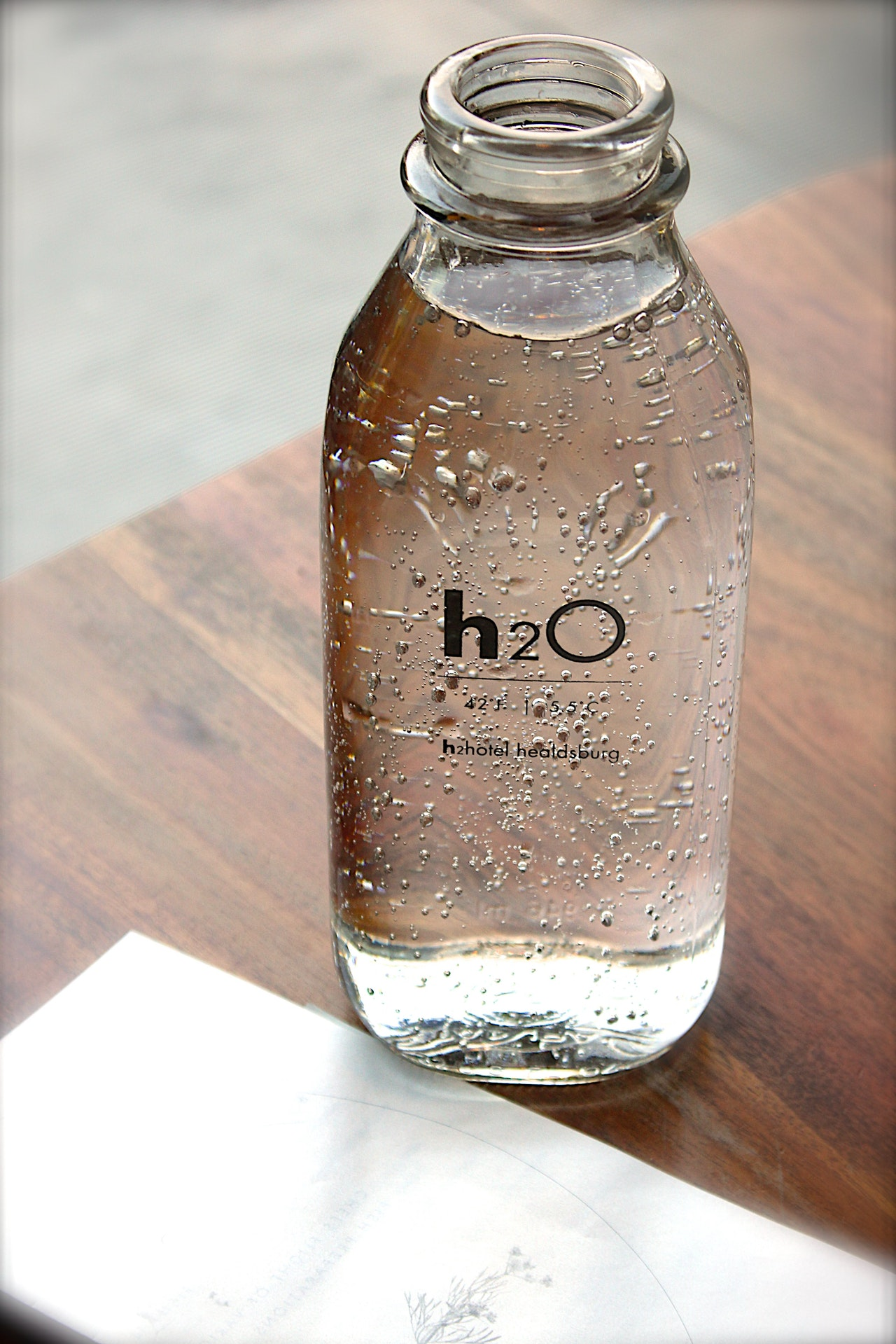 water in a clear water bottle that says h2o