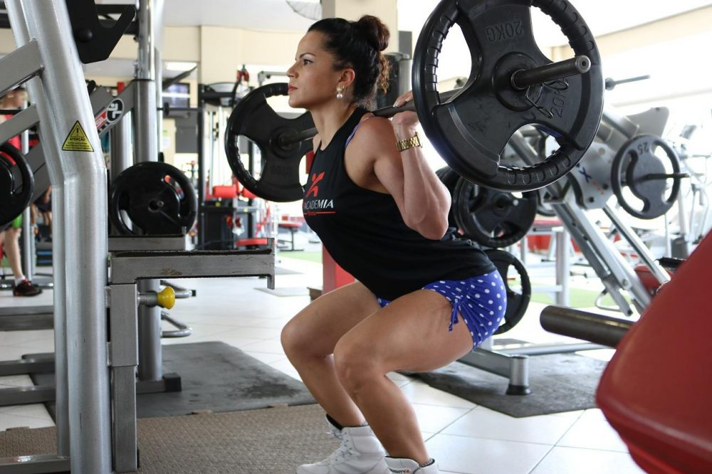 Woman doing a squat with weights