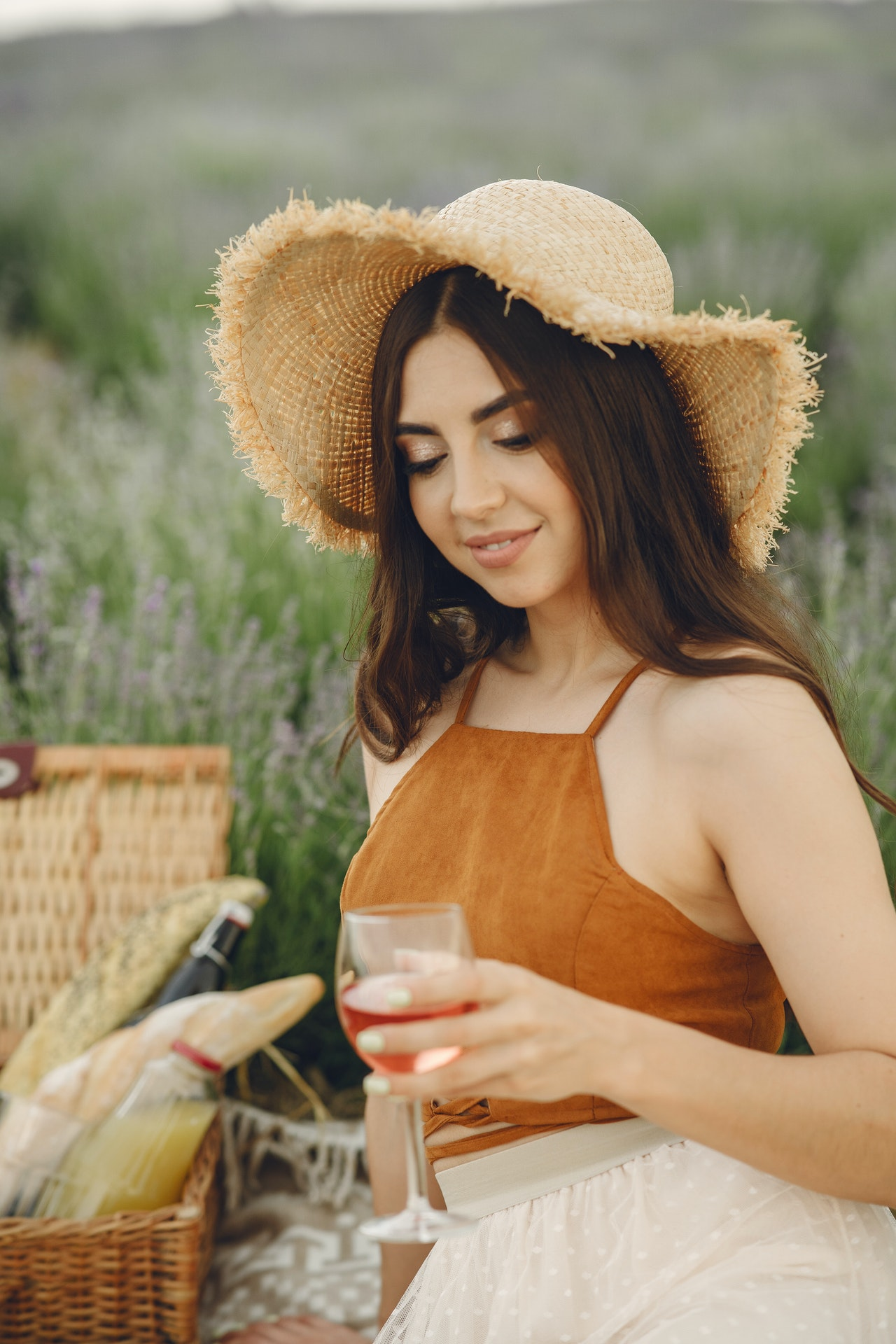 woman drinking wine in a park