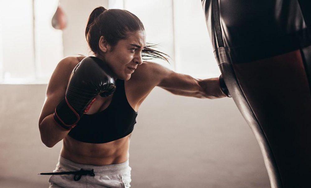 woman boxing using a boxing bag