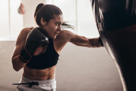 woman boxing using a boxing bag