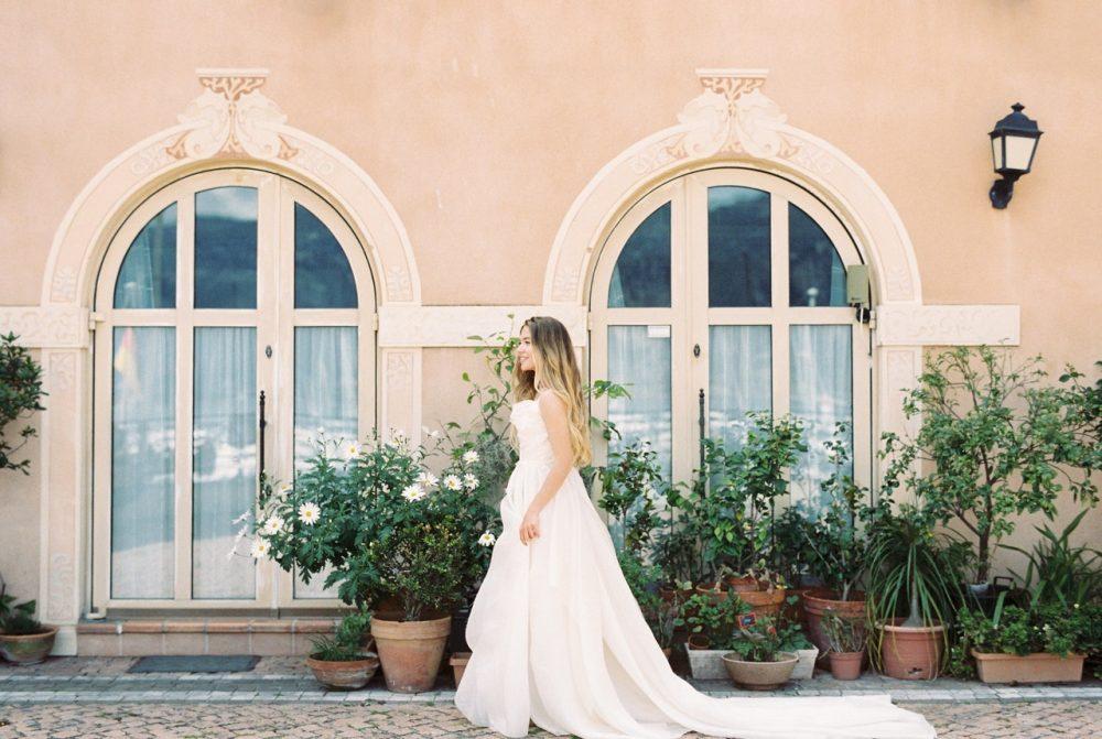 bride walking next to plants