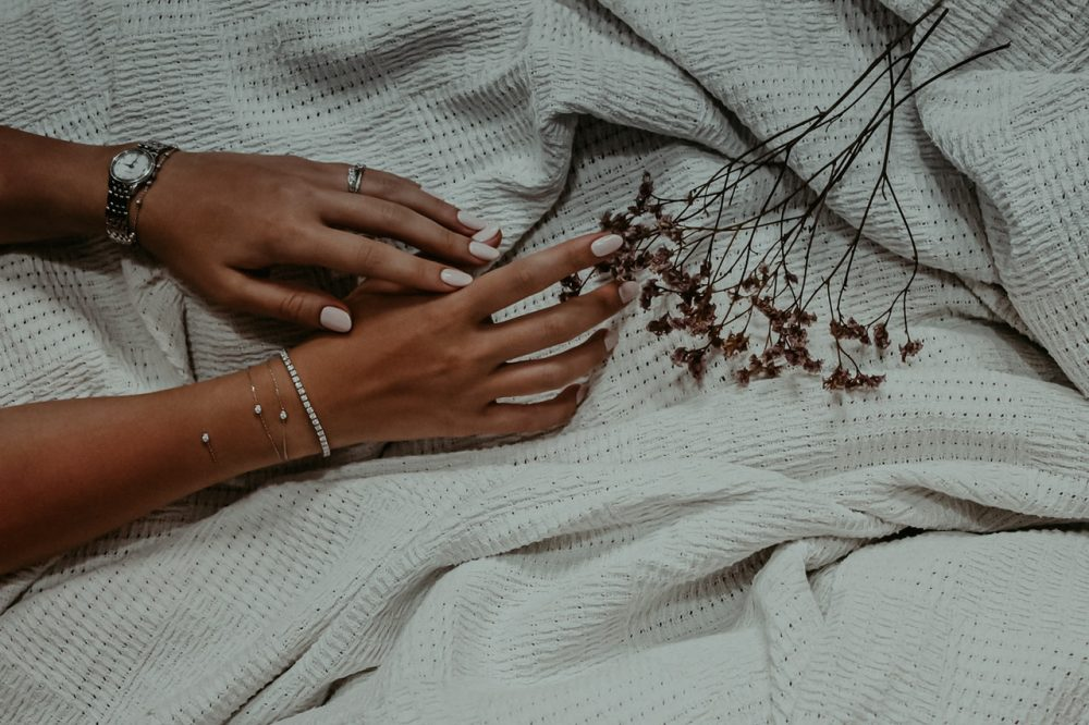 woman's hand showing off diamonds and manicure