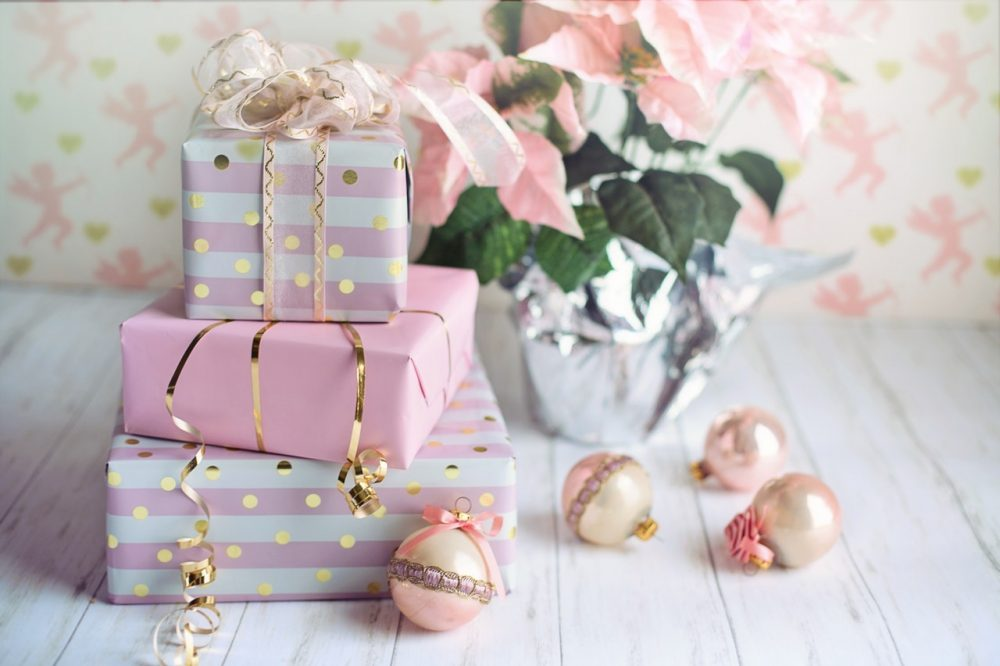 Christmas gifts wrapped in pink and gold wrapping paper.