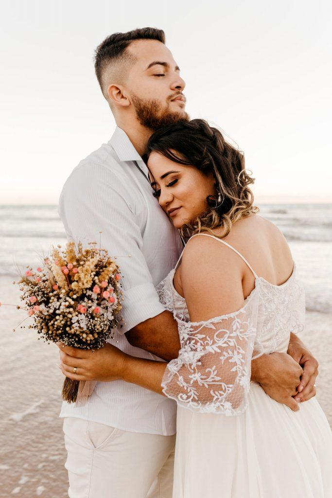 couple hugging on wedding day