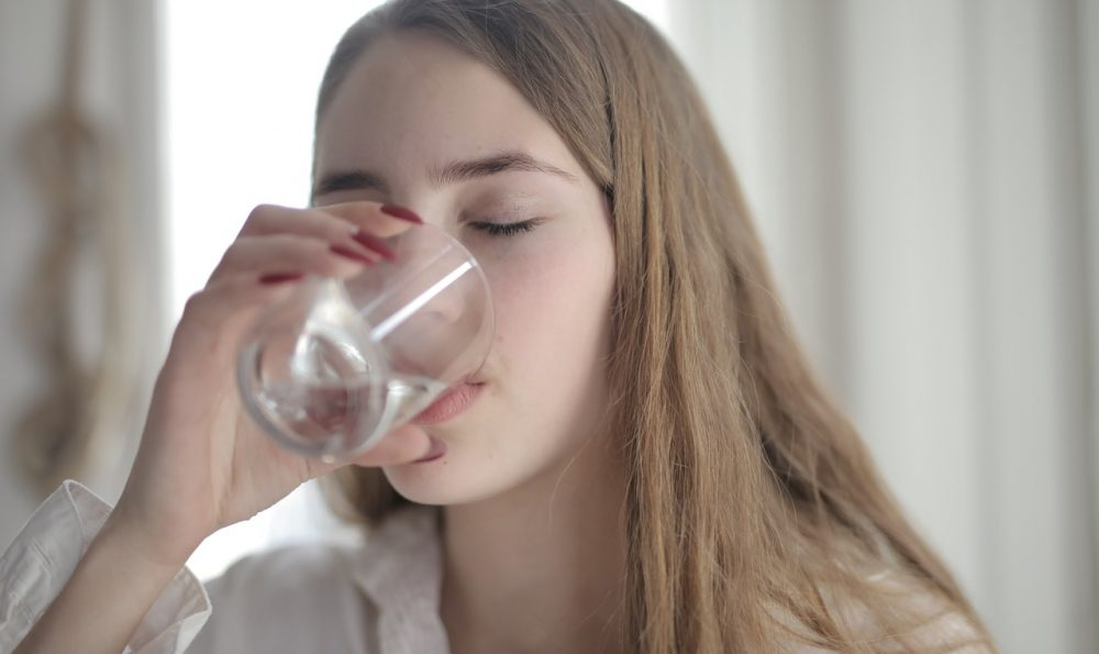 woman drinking filtered water
